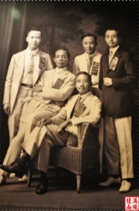 Five persons seated