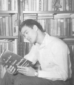 Bruce Lee reading a book