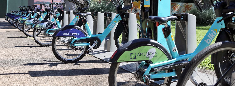 Biki bikes lined up at Biki stop near Hamilton Library