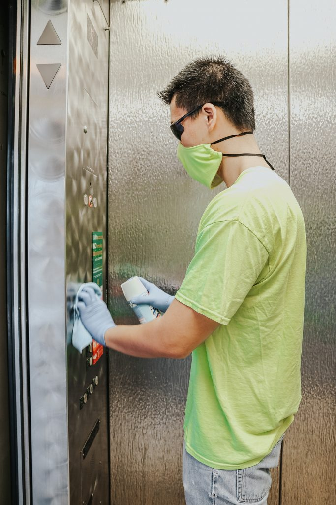 Cleaning high buttons in elevators