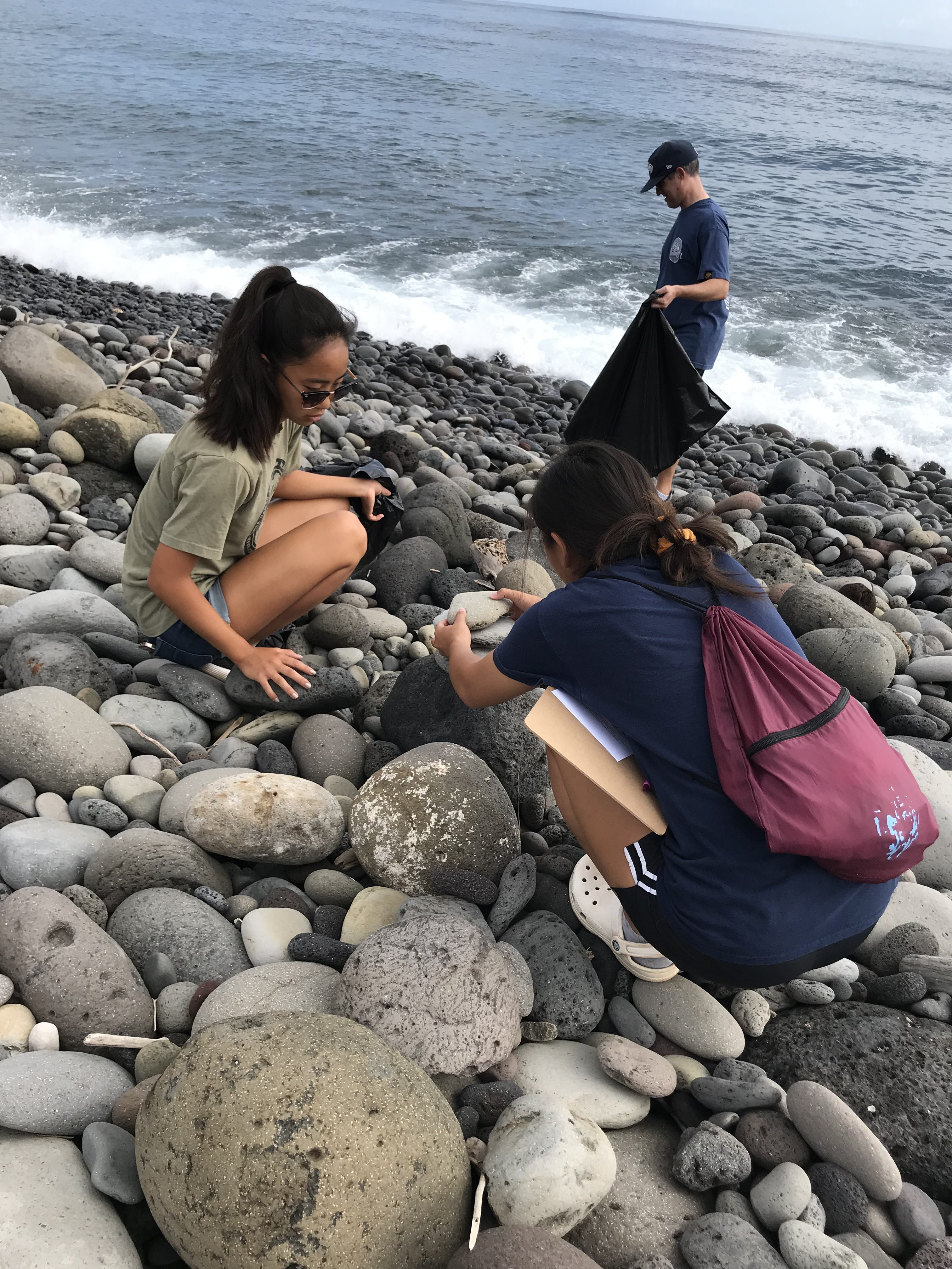 Bagging trash at 2019 Beach Clean Up