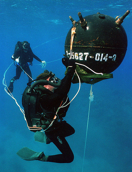 <p><strong>Fig. 9.28.</strong> A US Navy diver wearing a rebreather system practices defusing an underwater mine.</p>