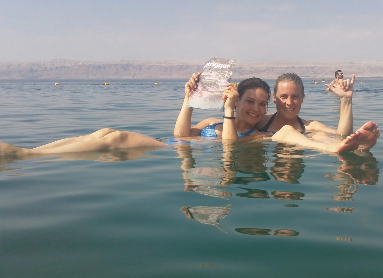 <p><strong>SF. Fig. 2.7.&nbsp;</strong>Catching up on the news in the Dead Sea. Try doing this in the ocean or a freshwater lake!&nbsp;</p>