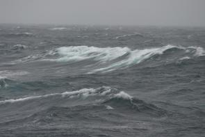 <p><strong>Fig. 4.7.</strong> A stormy sea state in the North Pacific basin has noticeable whitecaps.</p><br />