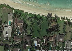 <p><strong>Fig. 5.29.</strong> An aerial view of Kailua Beach on O'ahu, Hawai'i. Based on current erosion rates, the two properties on the right side of the image are sufficiently set back from the coastline. In contrast, the two properties on the left side of the image have <em>insufficient</em> setback distance.</p><br />