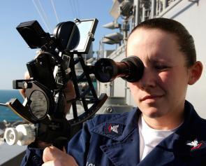 <p><strong>Fig. 8.26.</strong> (<strong>A</strong>) A sailor uses a sextant aboard the US Navy aircraft carrier <em>USS Harry S. Truman</em></p>