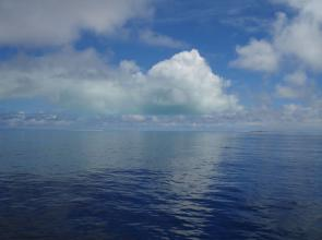 <p><strong>Fig. 8.5.</strong> (<strong>B</strong>) Flat atolls do not have peaks that can be seen from afar. However, navigators can see a reflection of the island in the clouds. This picture is of Kure Atoll, Northwestern Hawaiian Islands.</p><br />