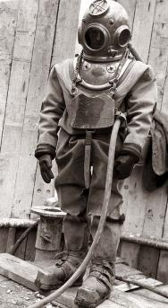 <p><strong>Fig. 9.22.</strong> A hard-hat dive suit used from the late1800s to the 1950s.</p><br />