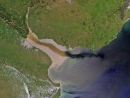 <p><strong>Fig. 2.3.</strong> (<strong>A</strong>) Aerial photo showing river runoff from the La Plata River in South America mixing into the ocean.</p>