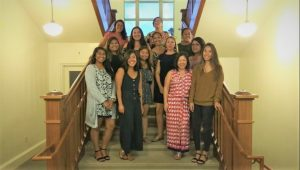 2018-2019 HCWEC Cohort Standing posing on staircase in Gartley Hall