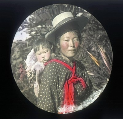 Japanese Woman Wearing a Straw Hat with Child on Back by Ray Jerome Baker with link to image source