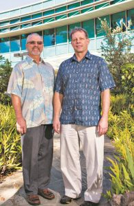 L-R: Dr. Karl and Dr. DeLong outside  the Daniel K. Inouye C-MORE Hale laboratory, UH Mānoa. Photo by Anthony Consillio