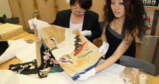 Two researchers examine kimono