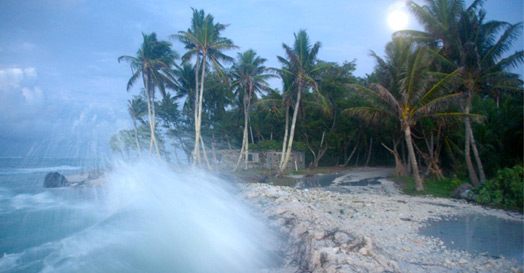 Waves crashing over roadway