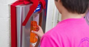 A student uses the new water bottle filling station at Kāneʻohe Elementary.