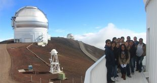 Maunakea Scholars and teachers on the Canada-France-Hawaiʻi Telescope catwalk in front of Gemini-North
