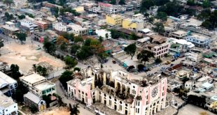 Feb. 27, 2010: An aerial view of Port-au-Prince, Haiti, from an MH-60S Sea Hawk helicopter assigned to the Military Sealift Command hospital ship USNS Comfort (T-AH 20), shows the devastation of the 7.0 earthquake that struck Haiti Jan. 12. Approximately 230,000 Haitians are reported to have died as a result of the earthquake. (U.S. Navy photo by Mass Communication Specialist 2nd Class Chelsea Kennedy/Released)