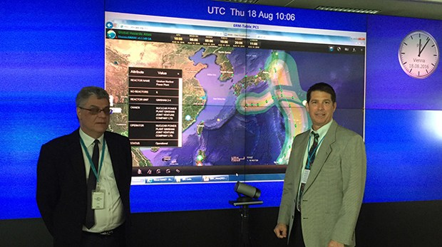 At the emergency operations center at IAEA headquarters PDC Deputy Executive Director Chris Chiesa and IAEA's Ovidiu Coman, senior nuclear engineering safety officer, use PDC's DisasterAWARE to display and identify nuclear power plants that may potentially be impacted by two tropical storms.