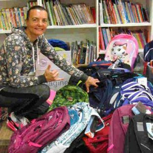 Chyba with donated backpacks and school supplies