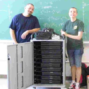 Monique Chyba (right) with donated laptops