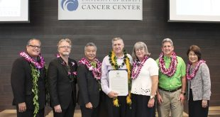 Gov. David Ige presents University of Hawaiʻi Cancer Center Day proclamation.