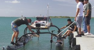 UH students preparing for the first international autonomous robotic vessel competition in Hawaiʻi.
