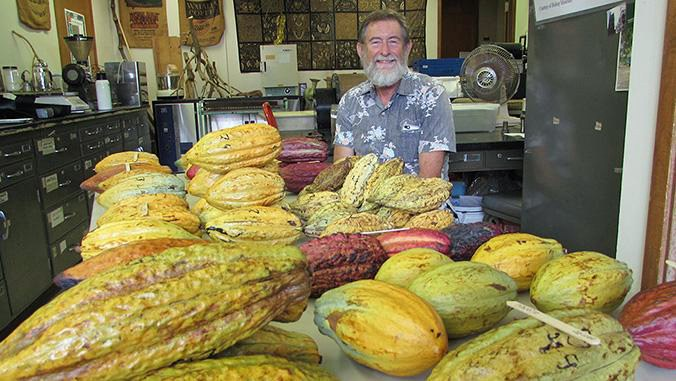 H.C. Bittenbender with cacao pods from his multi-site field trial.