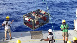 Researchers recover the trap after it landed on the bottom of the Mariana Trench. Photo credit: Paul Yancey