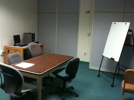 Table and chairs in presentation practice room
