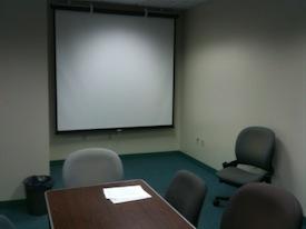 Projector screen in presentation practice room