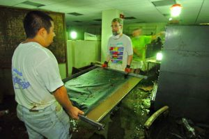 Workers removing muddy maps from the ground floor.