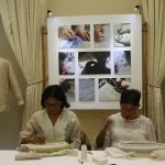 Two women demonstrating Pina-seda Embroidery