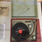 "A record player with a ""hit list"" from 1997"