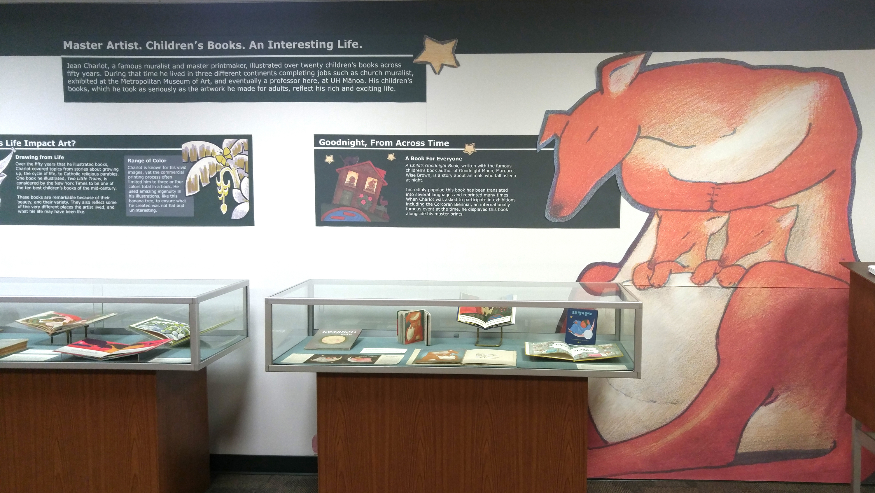 A wall illustration of a kangaroo flanking the Jean Charlot's Children's Book display