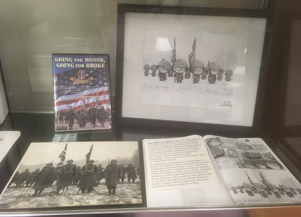 Going for Honor, Going for Broke DVD. A photo and graphic novel depicting soldiers holding 2 flags