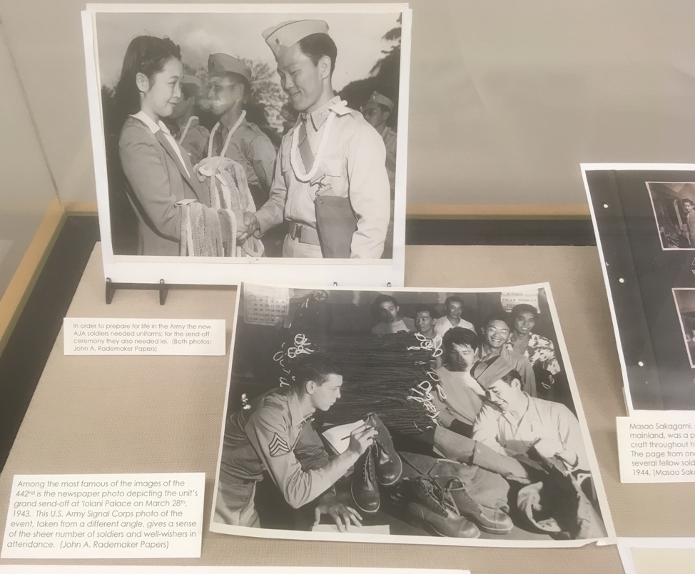 Photos showing soldiers accepting leis and uniforms