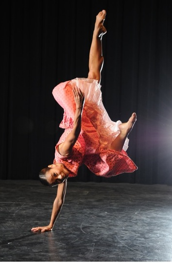 Photo from Fall Footholds; performer on one hand