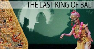 The last King of Bali show title and female dancer in front of giant shadow puppet screen