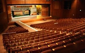 Photo of Kennedy Theatre auditorium and stage with a set in the background