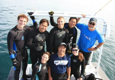 Divers on boat in ocean