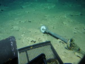 This dislodged engine room telegraph lies off the starboard bow of the USS Kailua. Credit: UH HURL.