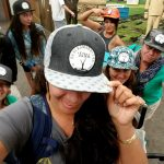 Kiana Frank and students repping their EA Hawaiʻi Field School hat
