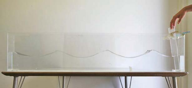 <p>Fig. 2. This long, clear container makes for an excellent tank to visualize waves being made.</p><br />