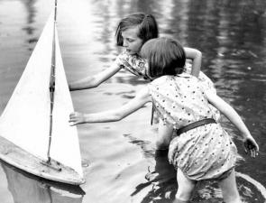 <p>Fig. 2. This image shows two girls playing with a toy sailboat in Seattle, Washington around the 1930's.</p>