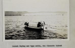 <p>Fig. 3. A boat launches the laying of the cable from hydrophone to the shore station for radio acoustic ranging operations.</p>