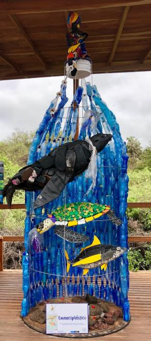"<p>Fig. 2. The sculpture entitled ""Emanciplástico"" stands over 10 feet tall at the Charles Darwin Research enter on the island of Santa Cruz in the Galapagos. The title represents a need for freedom from plastic and is made from plastic materials collected on the shores of the Galapagos Islands.&nbsp;</p><br /> <p>To learn more about their process in this project, check out the <a       href=""https://www.darwinfoundation.org/en/blog-articles/430-changing-attitudes-towards-plastic-pollution-through-art"">DarwinFoundation.org</a></p><br />"