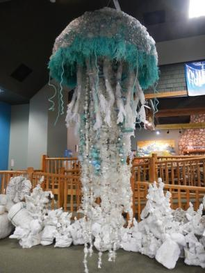 """<p>Fig. 7. This jellyfish sculpture is made from marine debris, mostly plastic water bottles, created by <a href=""""https://washedashore.org"""">Washed Ashore</a>.</p>"""