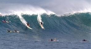 <p><strong>Fig. 1.</strong> Surfers ride a large wave at Waimea Bay, Hawai'i.</p>