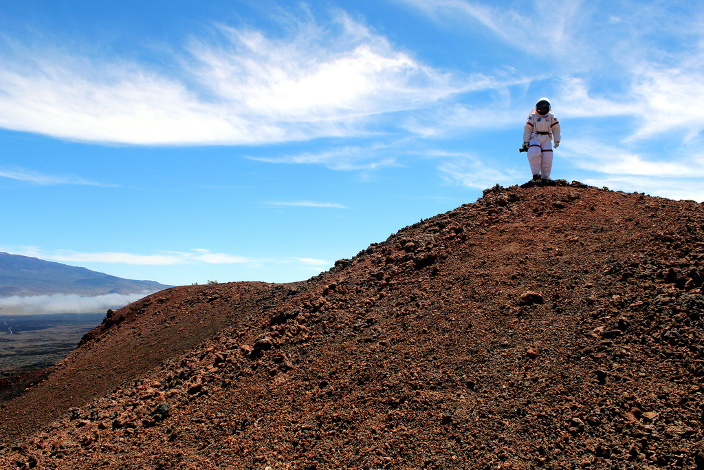 HI_SEAS crewmember standing atop a mound on Maunaloa