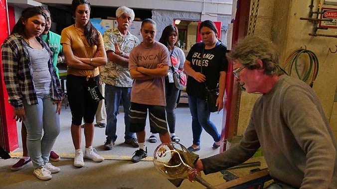 Rick Mills demonstrates glass shaping techniques for Molokaʻi High School students